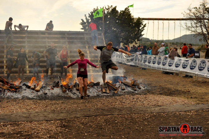 Ryan & I jumping the fire to finish the Spartan Beast in Glen Rose, TX together.