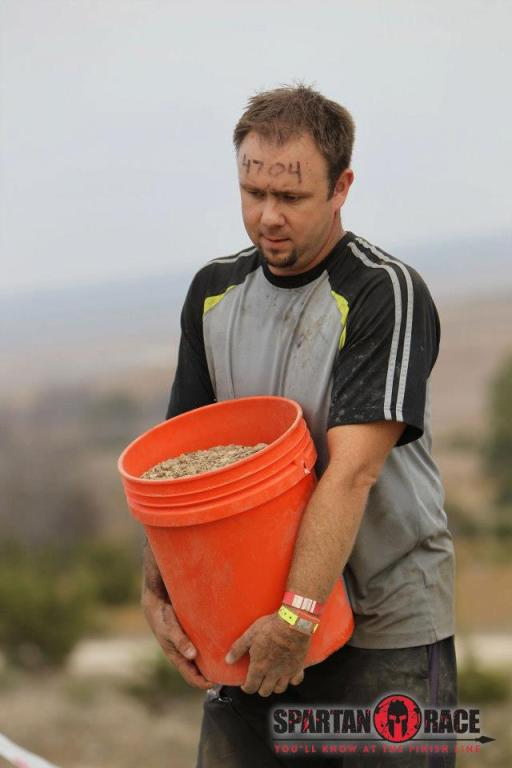 Ryan carrying his 5 gallon bucket of pea gravel.