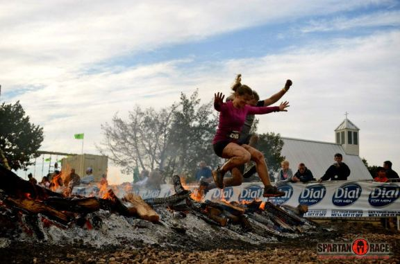 Conquering the Spartan fire together. (This was actually from the 2012 Beast.)